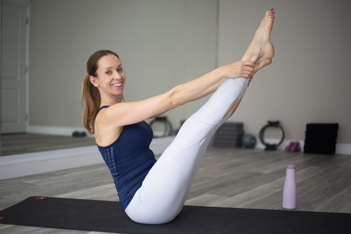 Linda performing a teaser position which works core, leg, shoulder and back muscles.