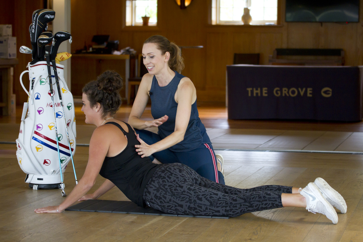 Linda and Lucy Goddard professional golfer from the Ladies European Tour working on a Cobra position.